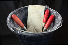 Masonry tools in a bucket Royalty Free Stock Photos