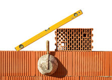 Masonry tools on red brick wall. Bricklaying work Royalty Free Stock Image