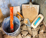 Masonry tools on an unfinished wall Royalty Free Stock Photos