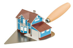 Masonry trowel with house, construction concept. 3D rendering. On white background Royalty Free Stock Image