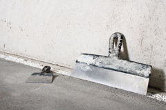 Masonry trowels and plaster wall Stock Photography