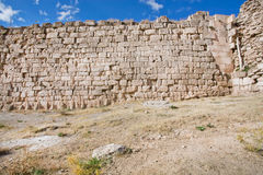Masonry wall of city fortification with bricks of different size and texture ander blue sky Royalty Free Stock Images