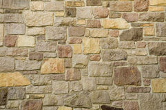 Masonry Wall of Multicolored Stone Stock Photography