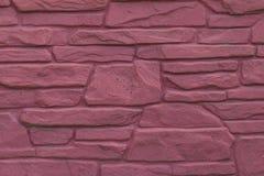 masonry wall of red stone Stock Photo