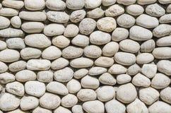 Masonry. Wall masonry. Round gray stones Royalty Free Stock Photos