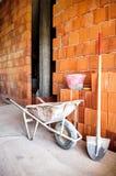 Masonry, wheelbarrow, bricks and shovel Royalty Free Stock Images