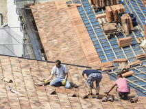 Masons to work on the roof for laying tiles Stock Image