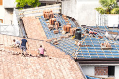 Masons to work on the roof for laying tiles Royalty Free Stock Image