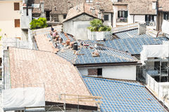 Masons to work on the roof for laying tiles Royalty Free Stock Photo