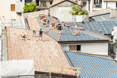 Masons to work on the roof for laying tiles Stock Photos
