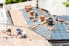 Masons to work on the roof for laying tiles Royalty Free Stock Images