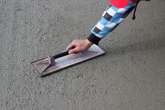 Masons trowel in hand Stock Photography