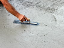 Masons trowel in hand Stock Images