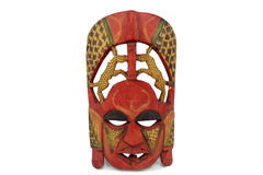 Masque africain en bois d'isolement sur le fond blanc Photo stock