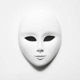 Masque blanc sur le livre blanc Image libre de droits