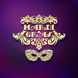 Masque d'or fleuri et inscription décorative sur le fond brouillé Mardi Gras Images stock