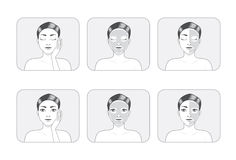 Masque de massage facial de femmes Photographie stock