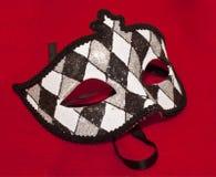 Masque de réception sur un fond rouge Images libres de droits