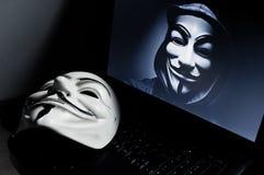 Masque de vendetta sur le computeur Photographie stock