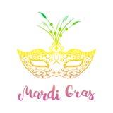 Masque et main de Mardi Gras marquant avec des lettres le texte calligraphique Mardi Gras Masque de partie pour le carnaval, gros Photos stock
