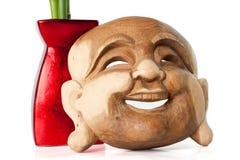 Masque et vase de Bouddha Images stock