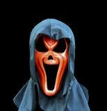Masque fantasmagorique au-dessus de fond noir Photographie stock