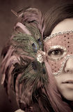 Masquerade. Mask on Female Half Face Shot with Abstract Antique Lighting