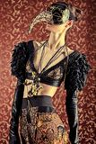 Masquerade. Fashion shot of a beautiful model over vintage background Royalty Free Stock Photo