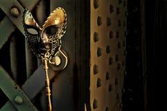 Masquerade. Venetian Mask on Vintage Bridge Stock Photos