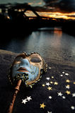 Masquerade. Venetian Mask by the River Bridge with Sunset