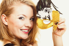 Masquerade. Beautiful girl in carnival mask Stock Photos