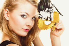 Masquerade. Beautiful girl in carnival mask Stock Photos