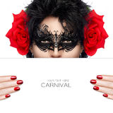 Masquerade. Beauty and Makeup Concept. Festive Nail Art and Make. Masquerade. Beautiful fashion model woman with elegant black mask and big red rose flowers on Royalty Free Stock Image
