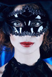Masquerade. Close-up portrait of a beautiful elegant woman in carnival mask stock photos