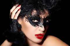 Masquerade. Closeup Short Hair Gorgeous Woman with Trendy Black royalty free stock photography