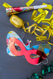Masquerade decorations on dark wooden background Royalty Free Stock Photos