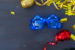 Masquerade decorations on dark wooden background Stock Photo