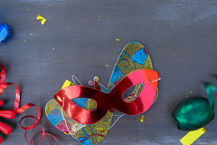 Masquerade decorations on dark wooden background Stock Image