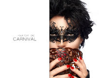 Masquerade. Gorgeous Short Hair Woman with Black Mask. Carnival Royalty Free Stock Photo