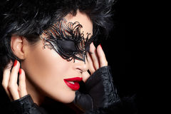 Masquerade. High Fashion Portrait of Beautiful Woman with Black Royalty Free Stock Photos