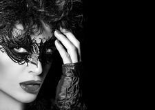 Masquerade. High Fashion Portrait of Mysterious Woman with Black Stock Photos