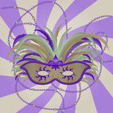 Masquerade Mardi Gras Mask. Masquerade-style Mask with beads and Fluer De Lis representing Mardi Gras Royalty Free Stock Photo