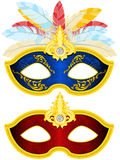 Masquerade Mask. Two Masquerade Mask with feather in different colors Stock Images