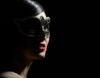 Masquerade mask. Cute girl in masquerade mask Royalty Free Stock Photography