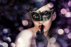 Masquerade mask. Cute girl in masquerade mask Stock Photo