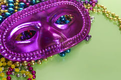 Masquerade mask and beads Royalty Free Stock Photo