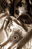 Masquerade mask, beads and feather royalty free stock photo