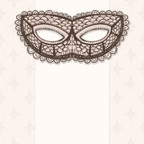 Masquerade mask on a beige background Royalty Free Stock Image