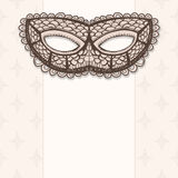 Masquerade mask on a beige background Royalty Free Stock Photography
