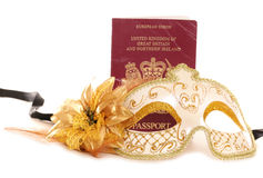 Masquerade mask and British passport Royalty Free Stock Images